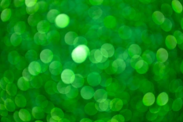 Lumières de noël de fond abstrait bokeh glister vert