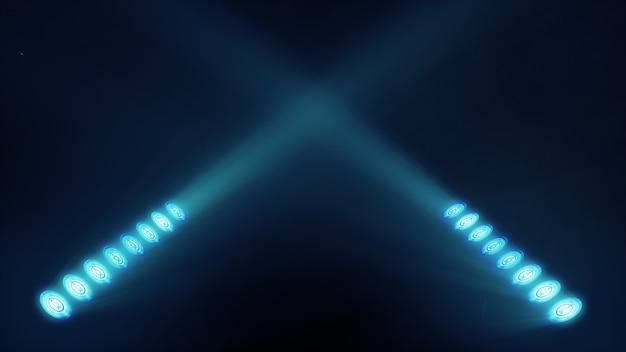 Des lumières de scène brillantes clignotent dans un endroit de couleur bleue pour votre espace de copie de texte