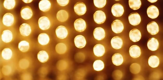 Lumières de vacances vintage comme arrière-plan abstrait pour la conception de noël et du nouvel an