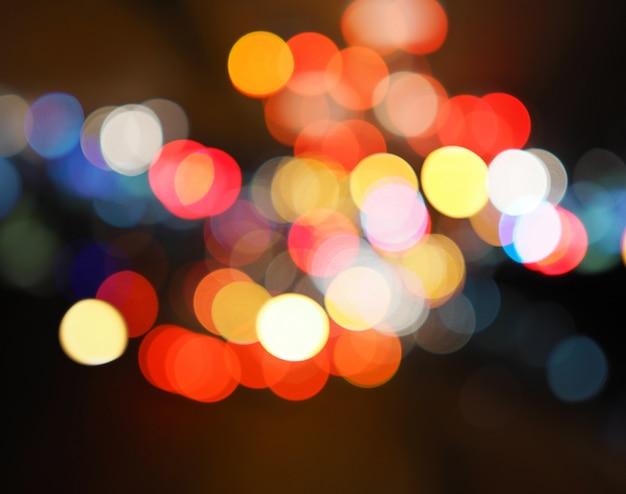 Lumières de la ville de nuit fond coloré bokeh, concept de ténèbres
