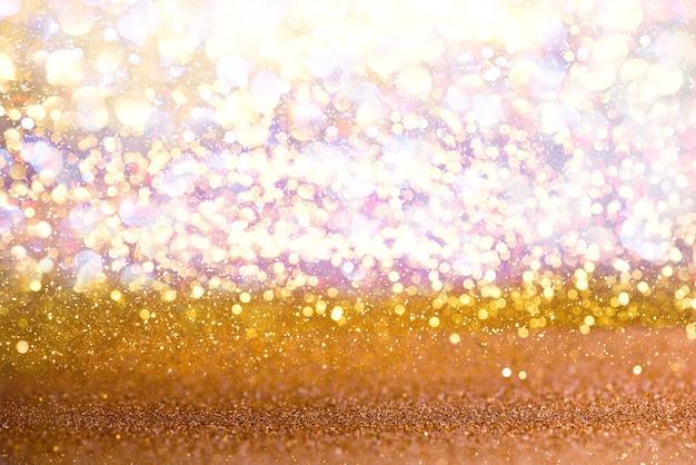 Lumières vintage or paillettes texture de fond. défocalisé