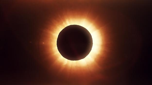 La lune couvrant le soleil dans une éclipse partielle.