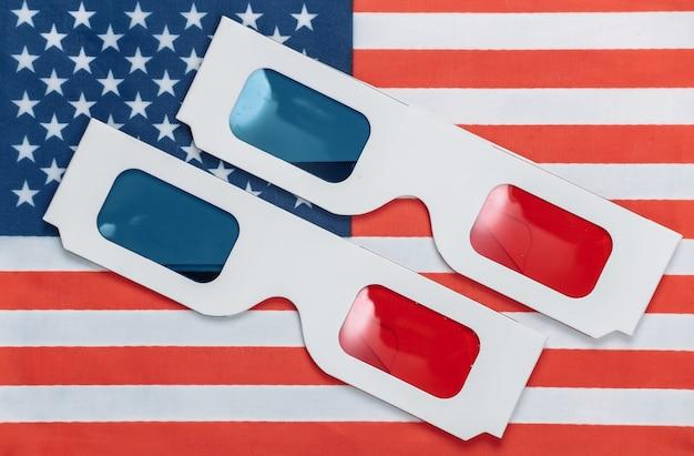 Lunettes 3d anaglyphes sur le drapeau des états-unis. blockbuster hollywoodien