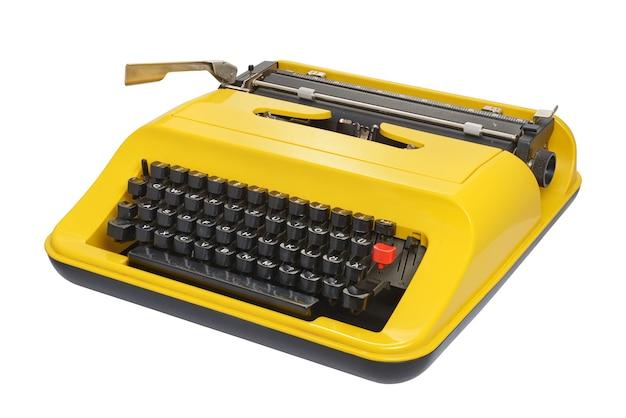 Machine à écrire jaune avec disposition du clavier allemand