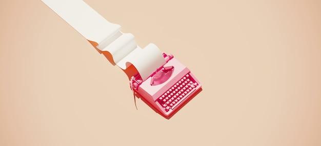 Machine à écrire vintage rose et rouleau de papier sur fond pastel