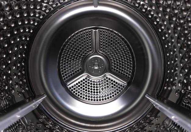 Machine à laver sèche-linge vue intérieure d'un tambour.