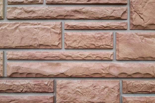Maçonnerie de carreaux décoratifs sur le mur d'un immeuble résidentiel