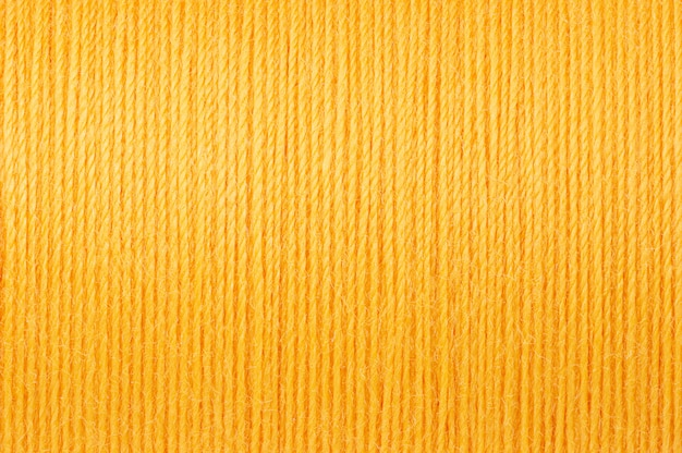 Macro image de fond de texture de fil jaune