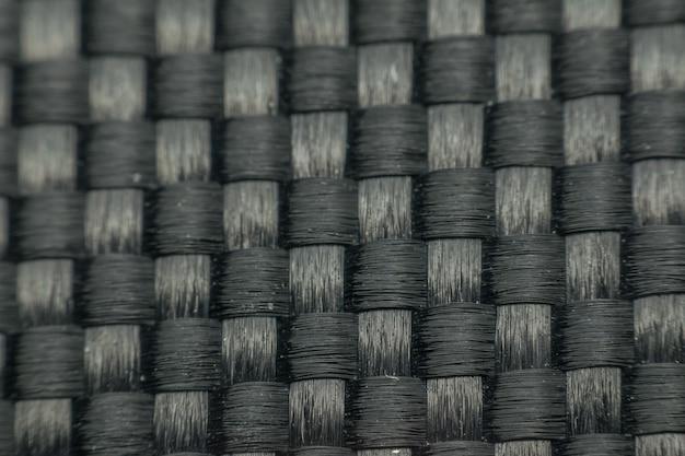 Macro de texture de surface tissée de texture de tissu noir pour l'arrière-plan