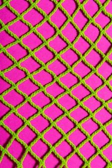 Maille textile, couleur verte et rose, fond texturé