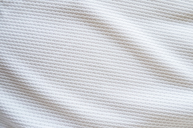 Maillot de football blanc vêtements tissu texture sports portent fond, gros plan