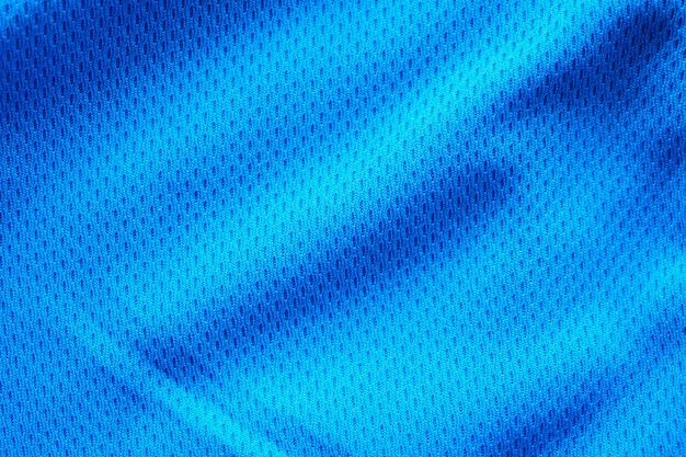 Maillot de football de vêtements de sport en tissu bleu avec fond de texture de maille d'air