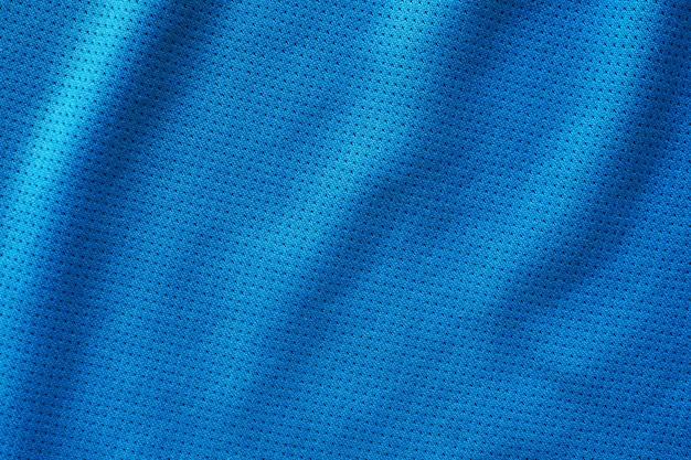 Maillot de football de vêtements de sport en tissu bleu avec fond de texture en maille d'air