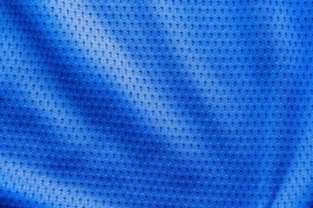 Maillot de football de vêtements de sport en tissu de couleur bleue avec fond de texture de maille d'air