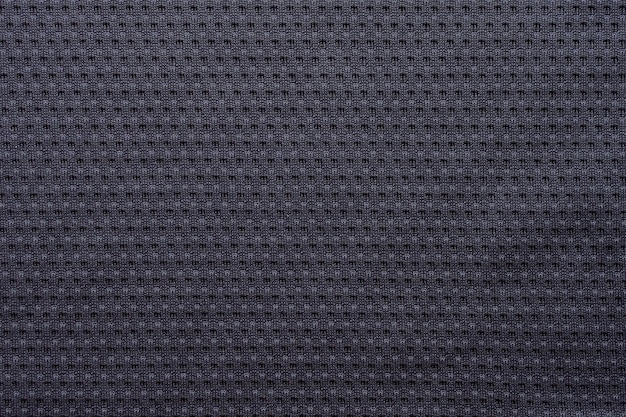 Maillot de football de vêtements de sport en tissu noir avec fond de texture de maille d'air