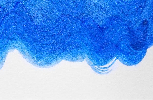 Main abstraite vague bleu dessiné fond de peinture acrylique