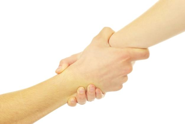 Main dans une main isolée sur blanc