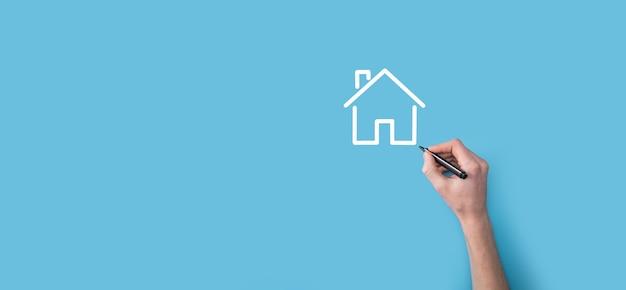Main dessiner une icône de la maison avec un marqueur. concept immobilier. assurance propriété et concept de sécurité. concept de réseau internet de technologie d'innovation.