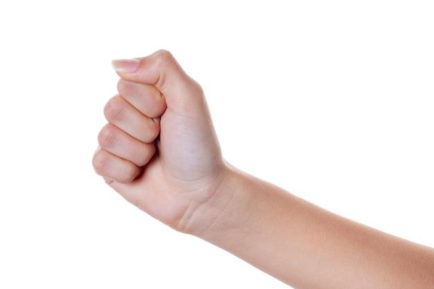 Main féminine avec les doigts pliés en poing isolé sur blanc. le langage du corps.