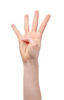 Main féminine montrant quatre doigts sur blanc