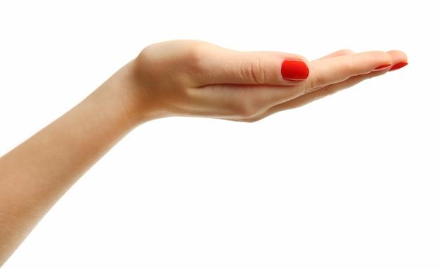 Main de femme faisant signe isolé sur une surface blanche
