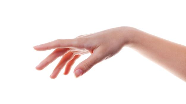 La main de la femme pointe un doigt sur quelque chose d'isolé sur blanc. le langage du corps.