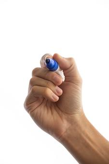 Main avec feutre bleu, dessin ou geste d'écriture