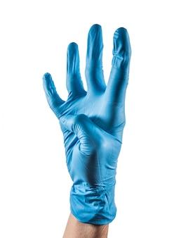 Main avec gant en latex bleu montrant quatre doigts