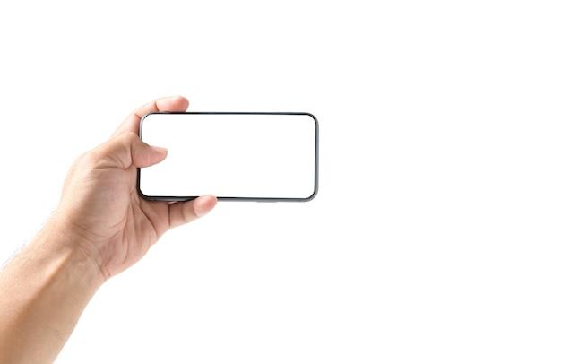 Main de l'homme à l'aide de smartphone avec écran blanc, isolé sur fond blanc