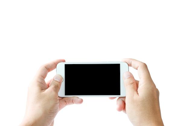 Main d'homme tenant un smartphone blanc avec un écran blanc noir.