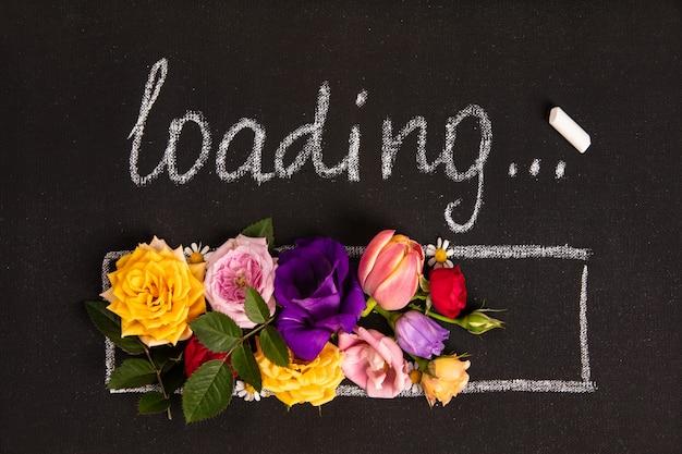 Main-noyer barre de chargement avec des fleurs