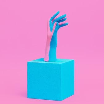 Main peinte créative en composition géométrique. conception visuelle minimale de mode