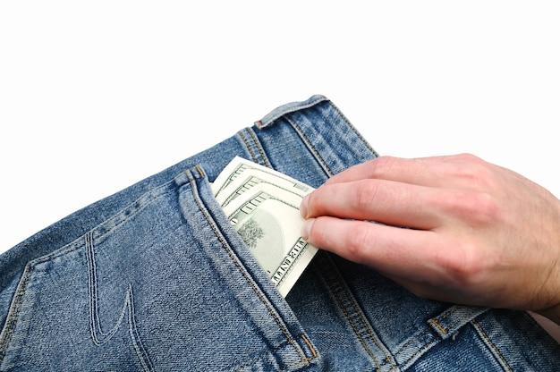 Main prend des billets d'un dollar dans la poche arrière d'un jean. photo de haute qualité