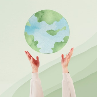 Main présentant le remix de l'environnement durable de la terre