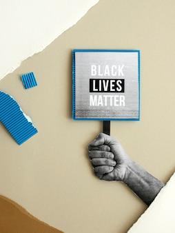 Main tenant le signe de la matière des vies noires