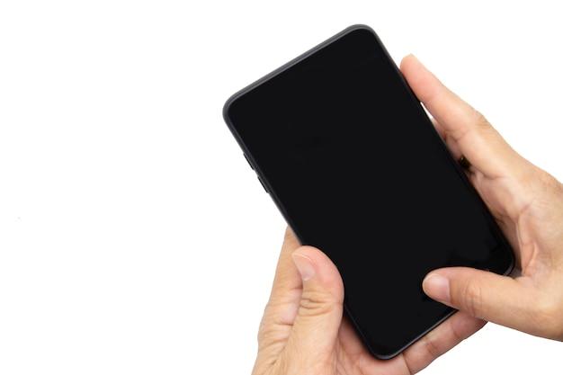 Main tenant le smartphone isolé sur blanc