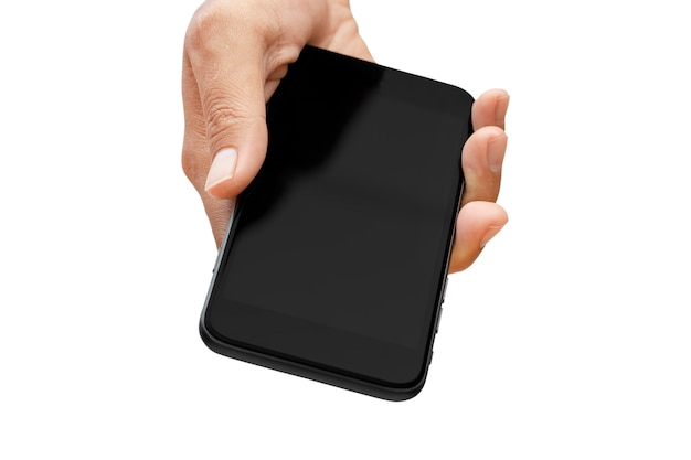 Main tenant le smartphone isolé sur mur blanc - chemins de détourage