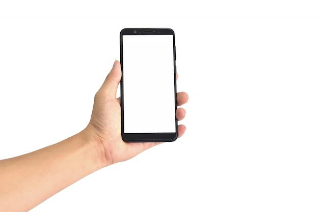 Main tenant un smartphone noir avec écran blanc, isolé