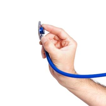 Une main tenant un stéthoscope
