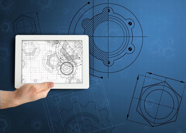 Main tenant la tablette avec des illustrations d'architecte