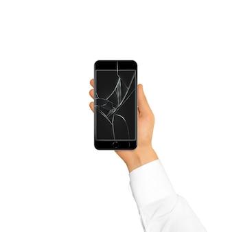 Main tenant un téléphone cassé noir