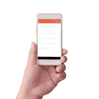 Main tenant un téléphone intelligent avec calendrier