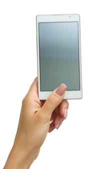 Main tenant un téléphone intelligent mobile avec écran vide