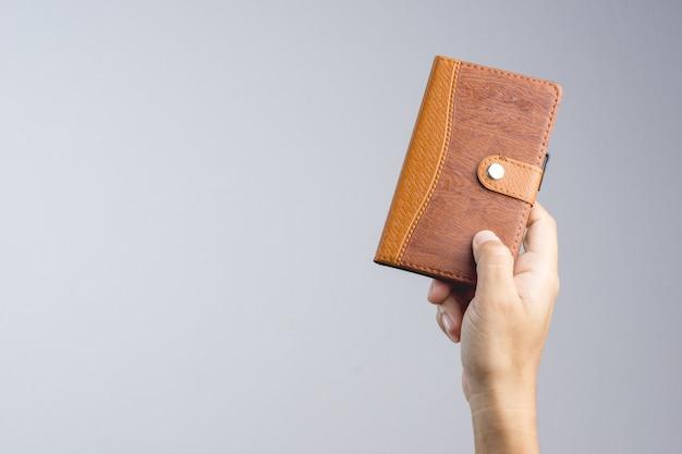 Main, tenue, cahier papier, couverture brun