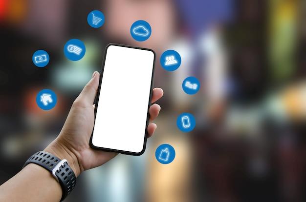 Main, tenue, smartphone, à, icônes, concept., application, et, réseau social, marketing numérique, achats en ligne