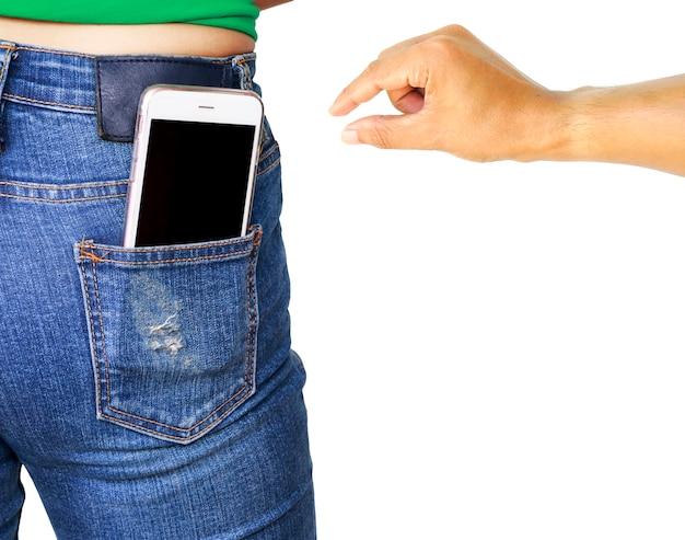 Main de voleur essayant de voler le téléphone portable