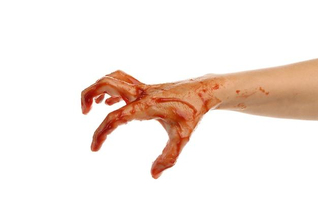 Main de zombie sang isolé sur blanc