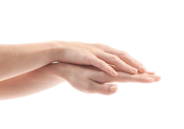 Mains féminines, isolées sur blanc