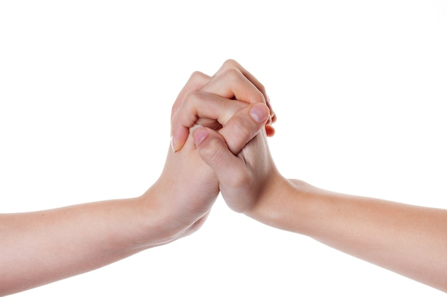 Mains de femmes tenant ensemble isolé sur blanc. le langage du corps.