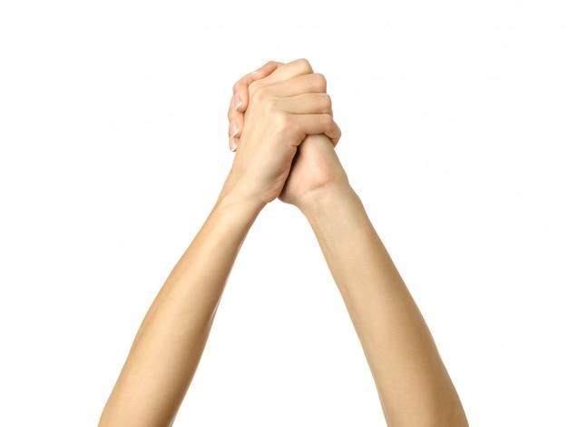 Mains jointes. main de femme gesticulant isolé sur blanc